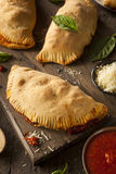 Homemade Italian Meat and Cheese Calzones Stock Photos