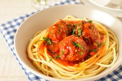 Meatballs with spicy tomato sauce on a plate. Homemade italian meatballs with spicy tomato sauce and classic spaghetti on a plate Stock Images