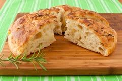 Homemade Italian rosemary Focaccia bread sliced. Stock Photography