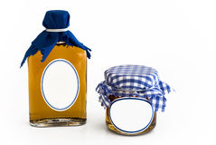 Homemade jam bottle and glass with blank label Royalty Free Stock Photos
