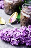 Homemade jam from the lilac. Unusual healing jam from the flowers of spring lilacs Royalty Free Stock Photos