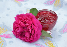 Homemade jam of rose petals in glass bowl and flower Stock Image