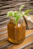 Homemade Jam of sea-buckthorn. Rustic homemade Jam of sea-buckthorn berries with honey and sugar royalty free stock photos