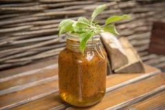 Homemade Jam of sea-buckthorn. Rustic homemade Jam of sea-buckthorn berries with honey and sugar stock photos