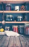 Homemade jam on shelves. Fresh various jars of homemade jam on shelves Stock Photography
