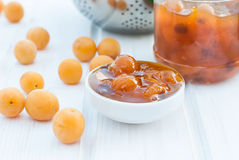 Homemade jam of yellow plum on a white board Stock Images