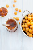 Homemade jam of yellow plum on a white board Stock Photography