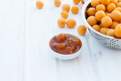 Homemade jam of yellow plum on a white board Royalty Free Stock Photography