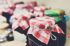 Homemade jams in glass jars for sale on country fair Stock Photos