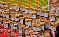 Homemade jams and honey on stall at summer fete Royalty Free Stock Photo