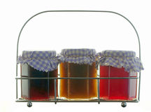 Homemade jams in a steel rack Royalty Free Stock Image