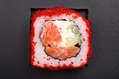 Homemade japanese roll with salmon, cucumber, cream cheese and r Royalty Free Stock Photography