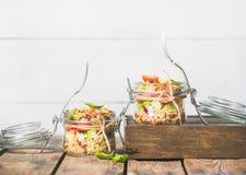 Homemade jar quinoa salad with tomatoes, avocado and basil. Healthy homemade jar quinoa salad with sun-dried and cherry-tomatoes, avocado and fresh basil. Detox Royalty Free Stock Photos