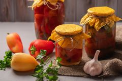 Homemade Jars Of Pickled Peppers And Tomatoes On A Rustic Wooden Background. Pickled And Canned Product. Next Royalty Free Stock Photos