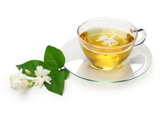 Homemade jasmine tea and arabian jasmine flower stock image