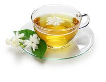 Homemade jasmine tea and arabian jasmine flower stock photos