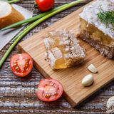 Homemade jelly meat with mustard, bread, tomatoes and garlic on the table. Holodets Royalty Free Stock Image