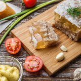Homemade jelly meat with mustard, bread, tomatoes and garlic on the table. Holodets Royalty Free Stock Photo