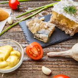 Homemade jelly meat with mustard, bread, tomatoes and garlic on the table. Holodets Stock Photo