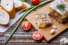 Homemade jelly meat with mustard, bread, tomatoes and garlic on the table. Holodets Stock Images