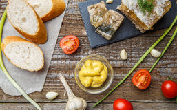 Homemade jelly meat with mustard, bread, tomatoes and garlic on the table. Holodets. Traditional Russian food Royalty Free Stock Photo
