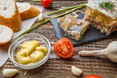 Homemade jelly meat with mustard, bread, tomatoes and garlic on the table. Holodets. Traditional Russian food Royalty Free Stock Image