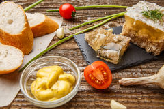 Homemade jelly meat with mustard, bread, tomatoes and garlic on the table. Holodets. Traditional Russian food Royalty Free Stock Photos