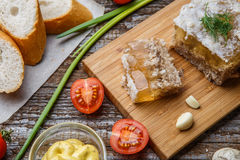 Homemade jelly meat with mustard, bread, tomatoes and garlic on the table. Holodets Royalty Free Stock Photography