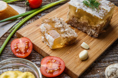 Homemade jelly meat with mustard, bread, tomatoes and garlic on the table. Holodets. Traditional Russian food Royalty Free Stock Photography