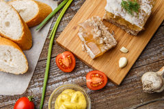 Homemade jelly meat with mustard, bread, tomatoes and garlic on the table. Holodets. Traditional Russian food Stock Photo