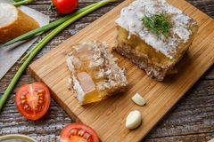 Homemade jelly meat with mustard, bread, tomatoes and garlic on the table. Holodets. Traditional Russian food Stock Images