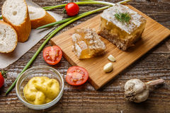 Homemade jelly meat with mustard, bread, tomatoes and garlic on the table. Holodets. Traditional Russian food Stock Photos