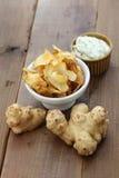 Homemade jerusalem artichoke chips Stock Photos