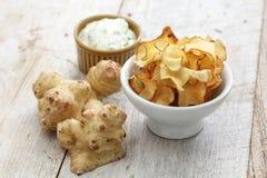 Homemade jerusalem artichoke chips Stock Image
