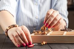 Homemade jewelry. Woman making home craft art bijouterie royalty free stock image