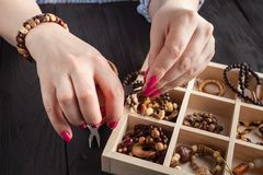 Homemade jewelry. Woman making home craft art bijouterie royalty free stock photos