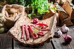 Homemade kabanos sausages in rural storeroom Royalty Free Stock Images