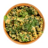 Homemade kale chips in wooden bowl over white stock photos