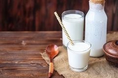 Homemade kefir, yogurt with probiotics in a glass on table Probiotic cold fermented dairy drink Trendy food and drink Copy space. Homemade kefir, yogurt with stock photography