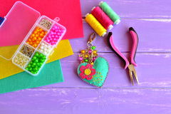 Homemade keychain felt embellished with beads. Box with beads, pliers, felt sheets, needle, thread Royalty Free Stock Images