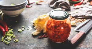 Free Homemade Kimchi , Fermented Chinese Cabbage Marinated In Hot Chili Sauce  In Jar On Rustic Background With Ingredients. Healthy Royalty Free Stock Photo - 171184655