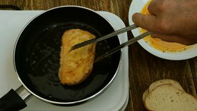 Homemade kitchen. Croutons or toasts of white bread, soaked in a beaten chicken egg. stock video