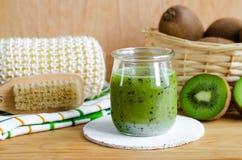Homemade kiwi beauty mask scrub in a glass jar. DIY cosmetics. Homemade kiwi mask scrub in a glass jar. DIY cosmetics stock image