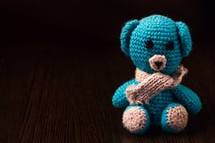 Homemade knitted bear on the table royalty free stock photos