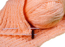 Homemade knitting of pink yarn Stock Photo