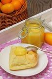 Homemade Kumquat Curd. Jam of kumquats with croissant for breakfast royalty free stock images