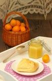 Homemade Kumquat Curd. Jam of kumquats with croissant for breakfast royalty free stock photos