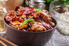 Homemade Kung Pao chicken with peppers and vegetables. Traditional sichuan dish Stock Photos