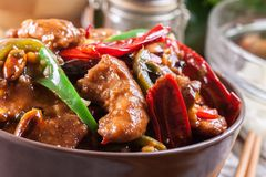 Homemade Kung Pao chicken with peppers and vegetables. Traditional sichuan dish Stock Image