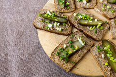Homemade lard and pickled gherkin on a slices of bread Royalty Free Stock Photography